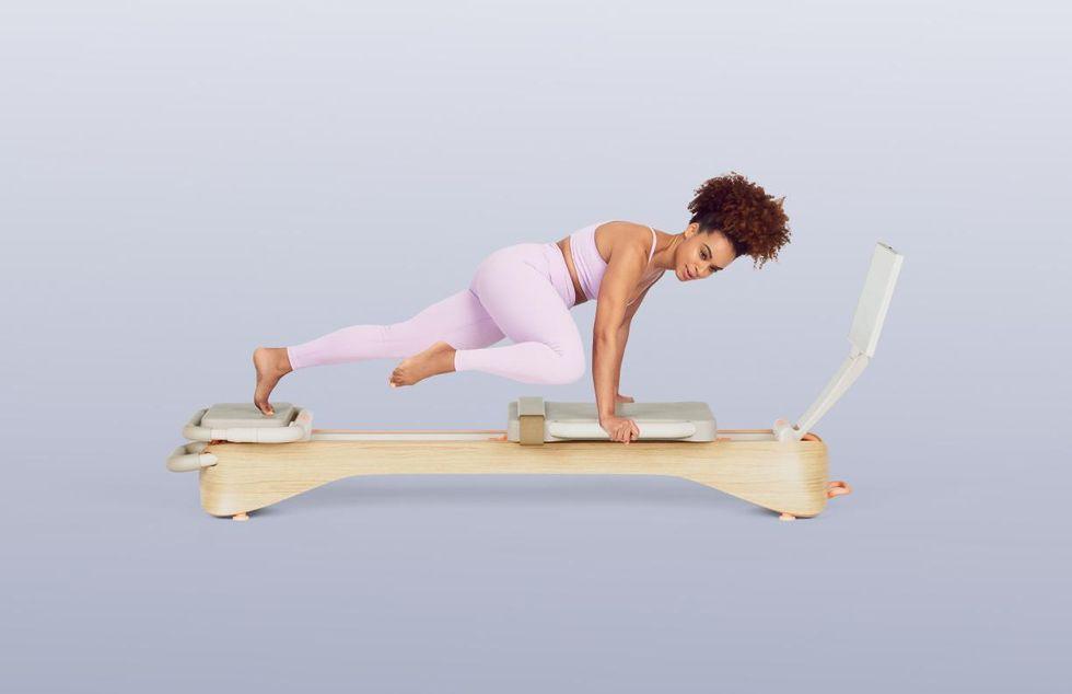 Frame Fitness reformer in use.